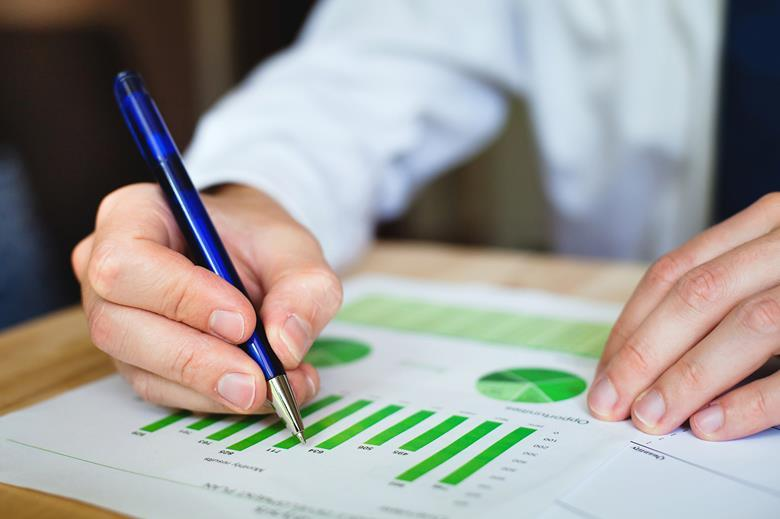 person reading sustainability reporting charts